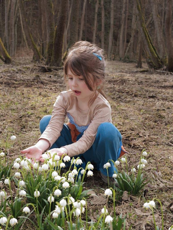 Girl with flowering snowflake