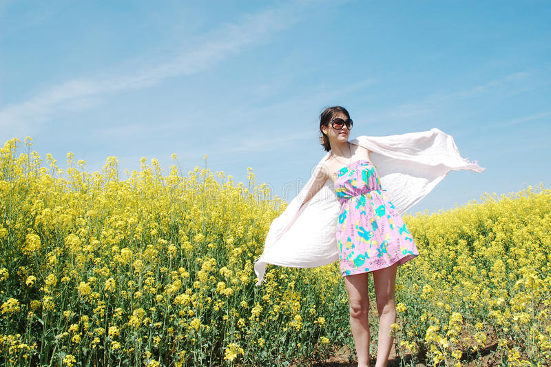 Girl and flowers royalty free stock images