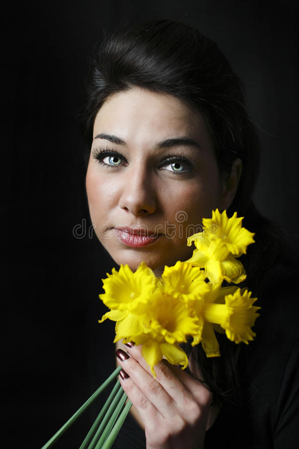 Download Girl with flowers stock photo. Image of grief, brunette - 19000840