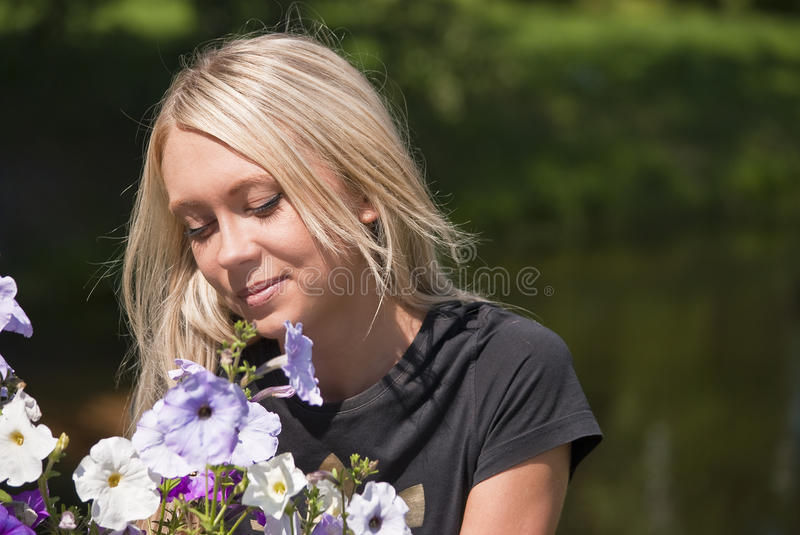 Girl and flowers royalty free stock image