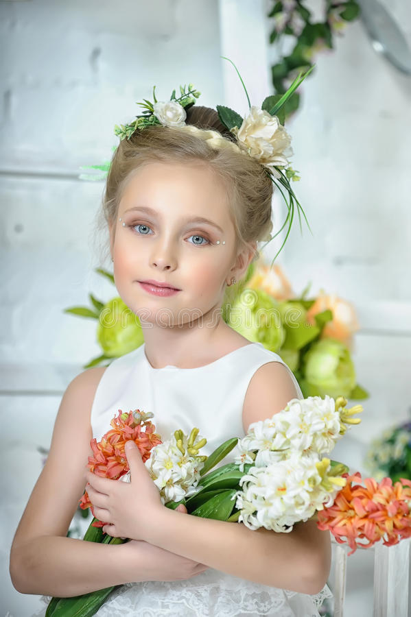 Girl with flowers. Vintage Girl with Flowers in her hair stock photos
