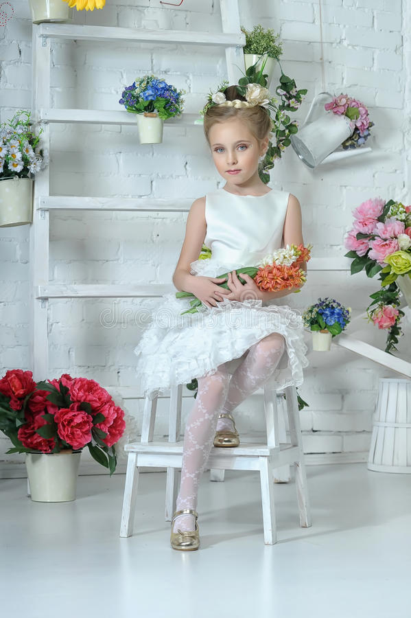Download Girl with flowers stock image. Image of book, elegance - 28419495