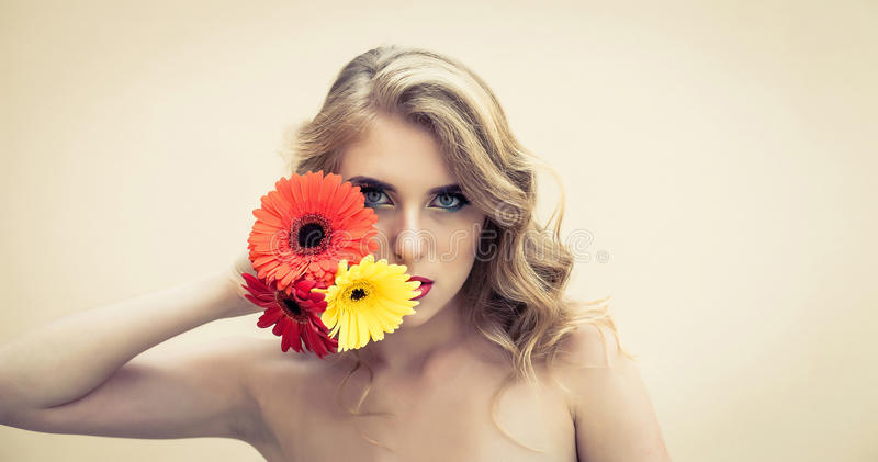 Girl with flowers. Beautiful girl with a nice flowers in hand stock photo