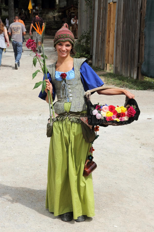 Download Girl With Flowers Dressed In Medieval Costume Editorial Image - Image: 17888750