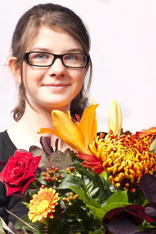 Girl with flowers smile royalty free stock photo