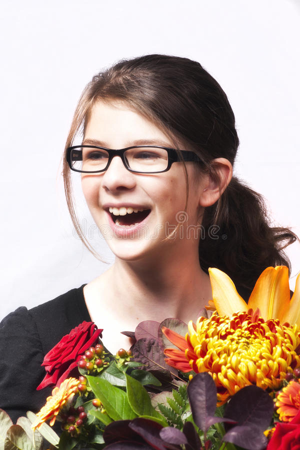 Girl with flowers smile royalty free stock photography