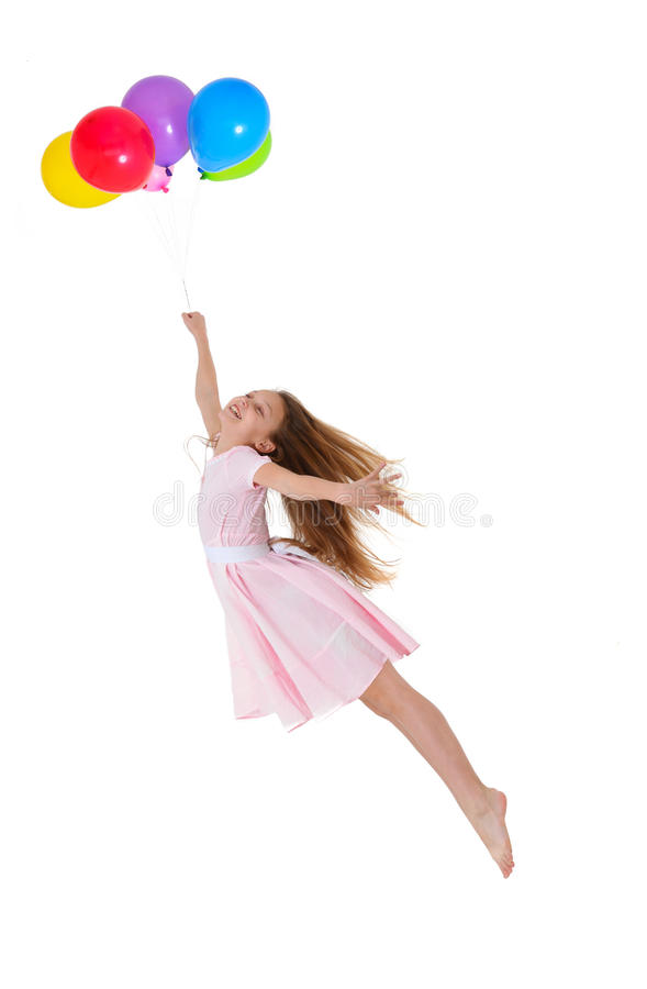 Girl flying with balloons royalty free stock photo