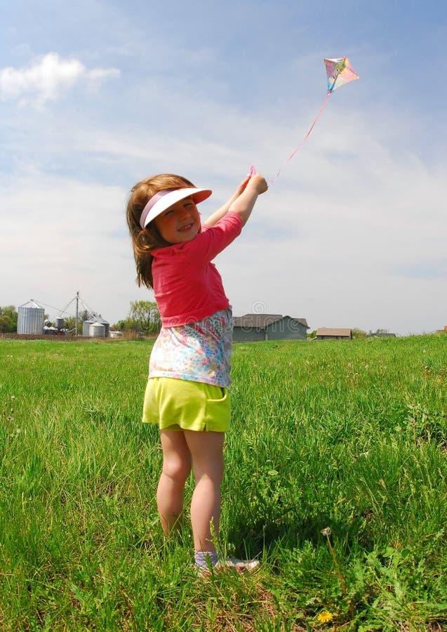 Girl flying kite stock photo