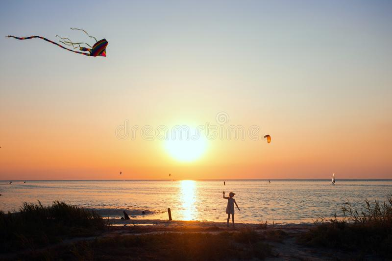 Girl flying a kite stock photo