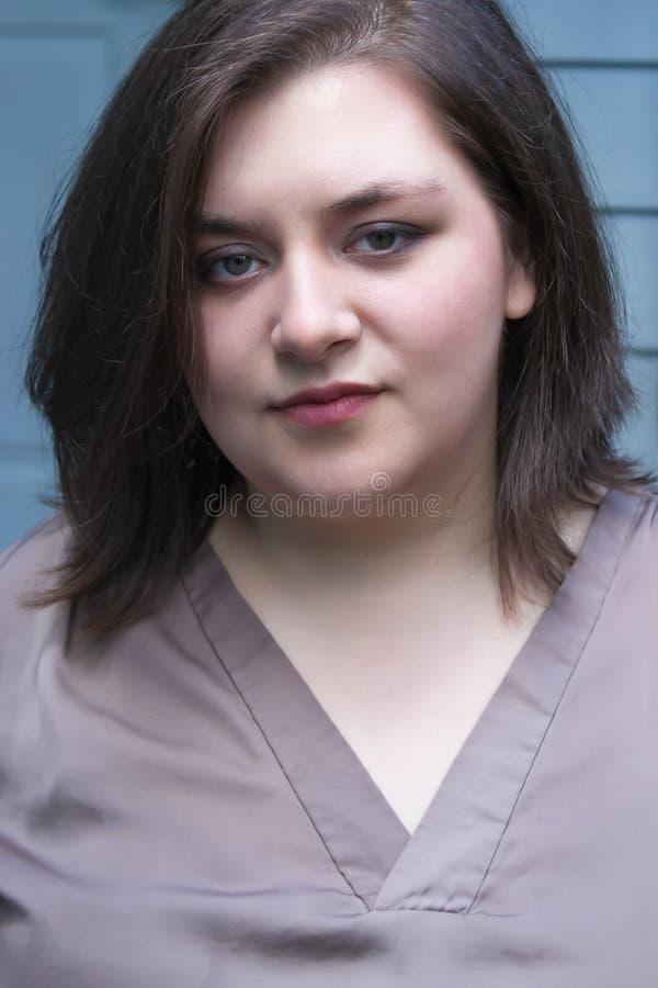 Girl focuses and looks forward against blue home stock photos