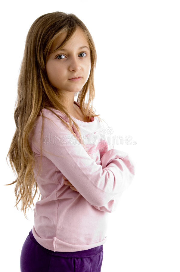 Girl with folded arms looking at camera. On white background royalty free stock photos