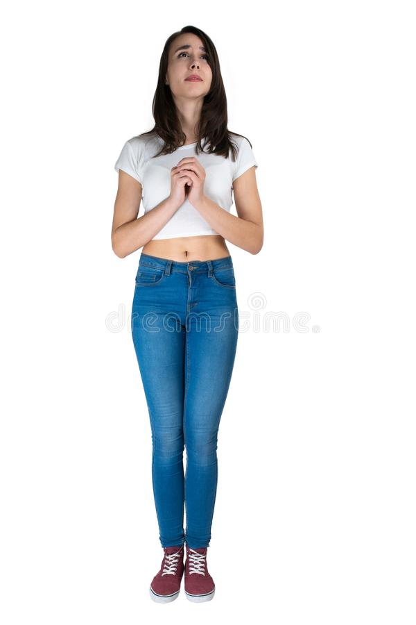 The girl folded her hands in prayer and looks up with hope stock photos