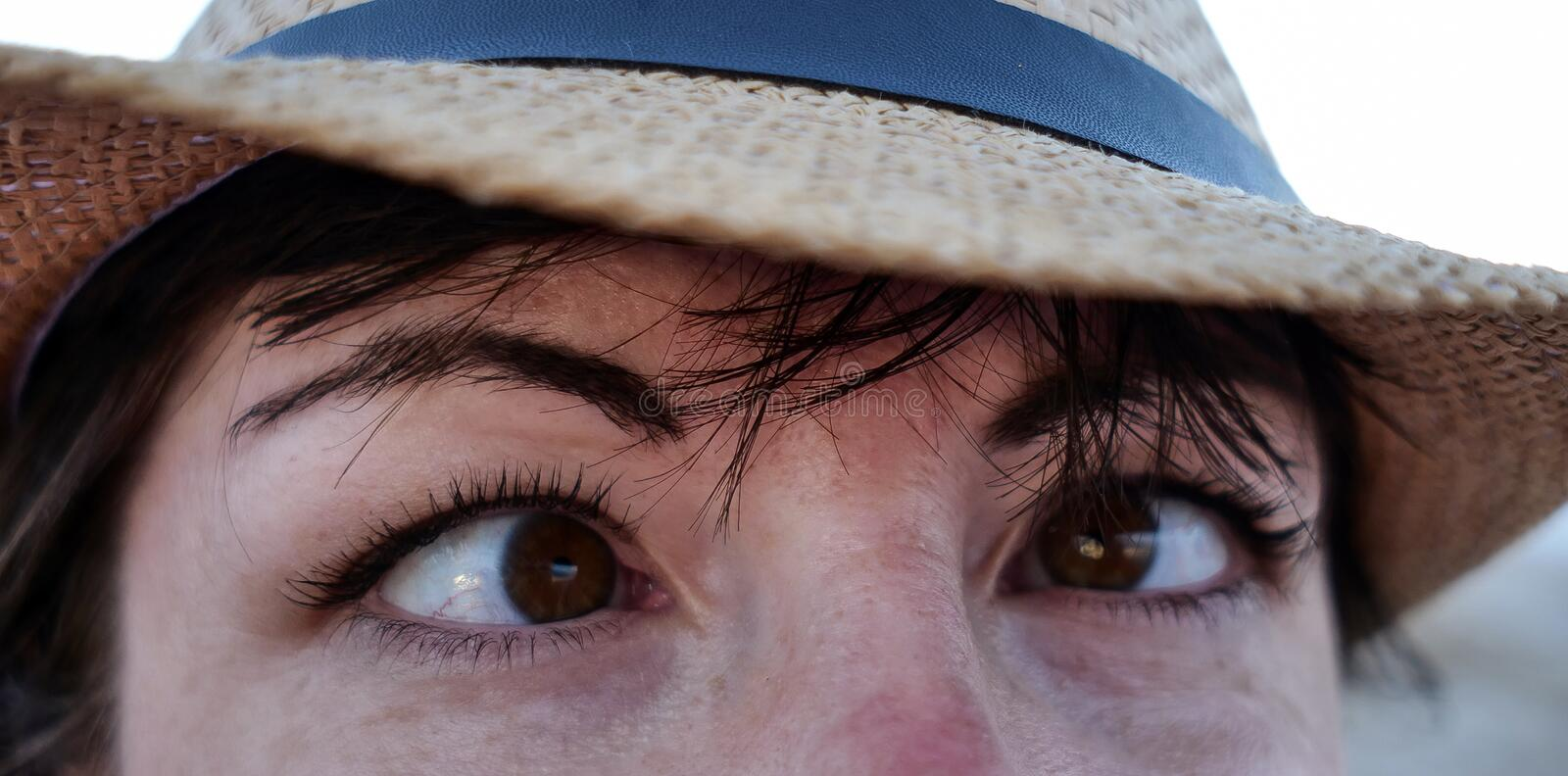 Girl fooling in front of the camera brings eyes together, close-up royalty free stock images