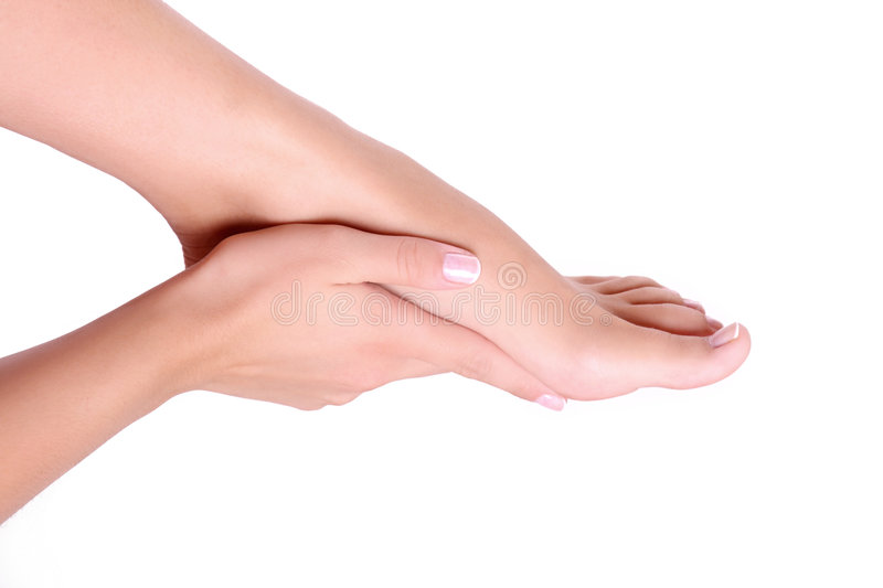 Girl foot and hand stock photo
