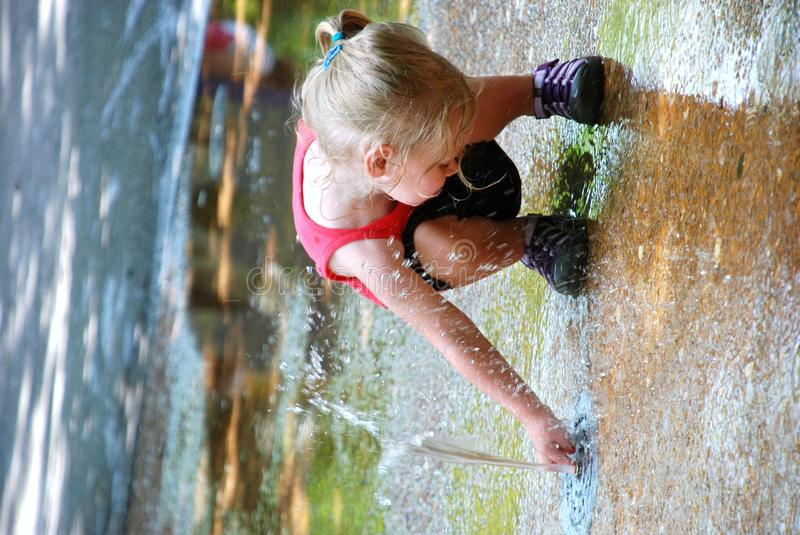 Girl And Fountain Royalty Free Stock Images