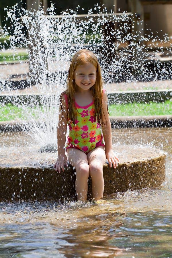Girl In Fountain Stock Photo