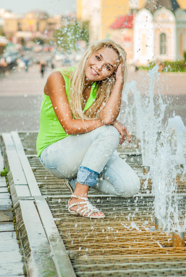 Girl about fountain royalty free stock photography