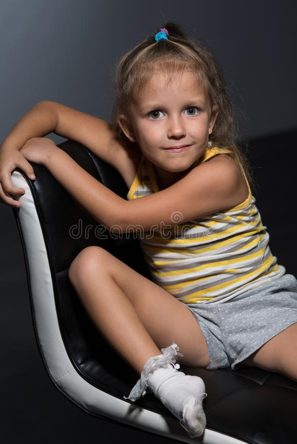 Girl four years on a chair stock photography