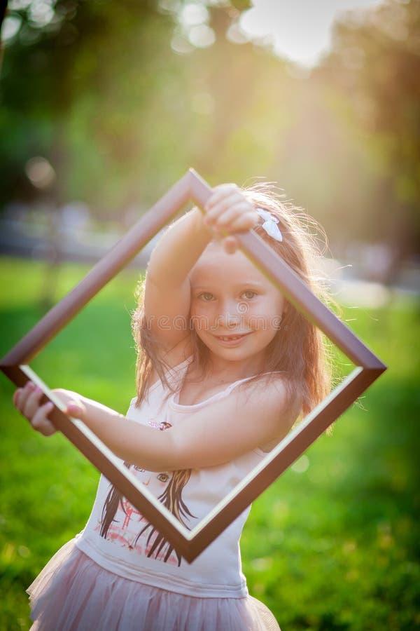 Girl and frame stock image