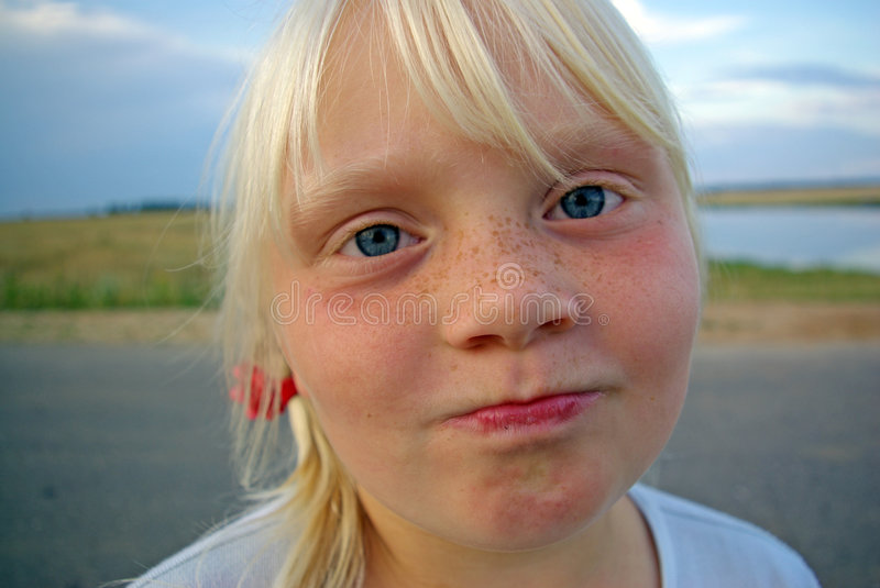 Girl with freckles stock images