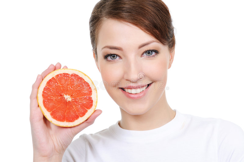 Girl with fresh grapefruit royalty free stock photography
