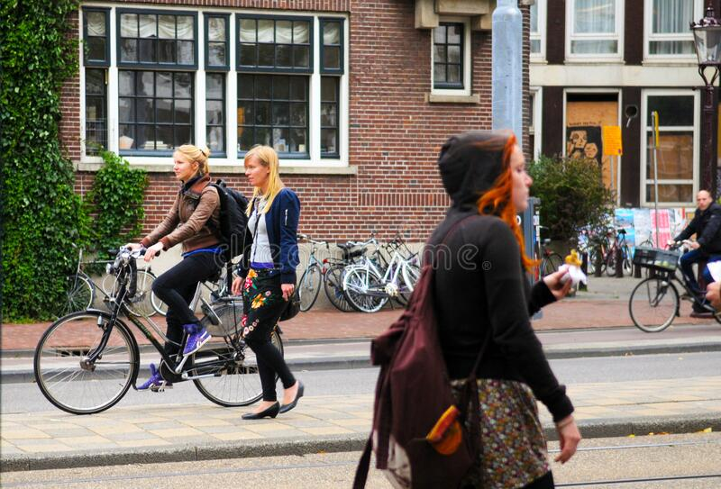 Girl Friends and a Bike, Netherlands City Scene, Dutch Lifestyle, Holland Urban Typical Scenery stock photos