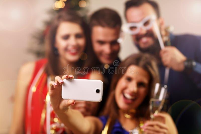 Girl friends celebrating New Year stock image