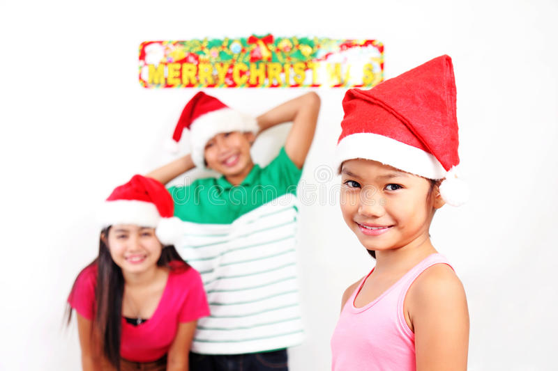 Girl With Friends At Christmas stock photography