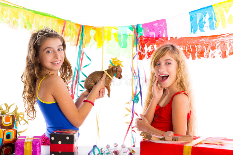Girl friends party excited with puppy dog present royalty free stock photo