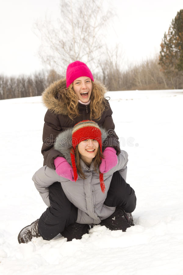 Girl Friends Playing In Snow Stock Photography