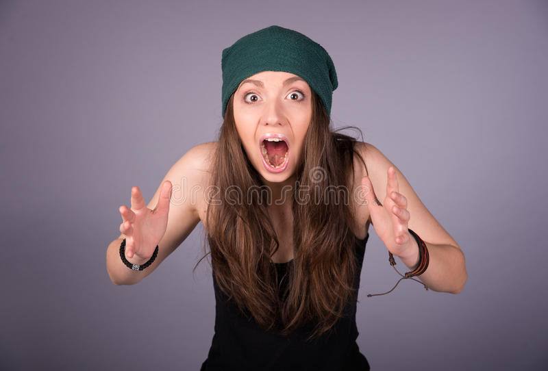 Girl. Frightened girl in a cap stock images