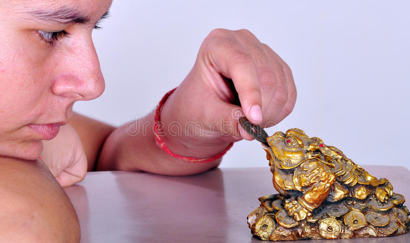 Girl with frog talisman royalty free stock photography