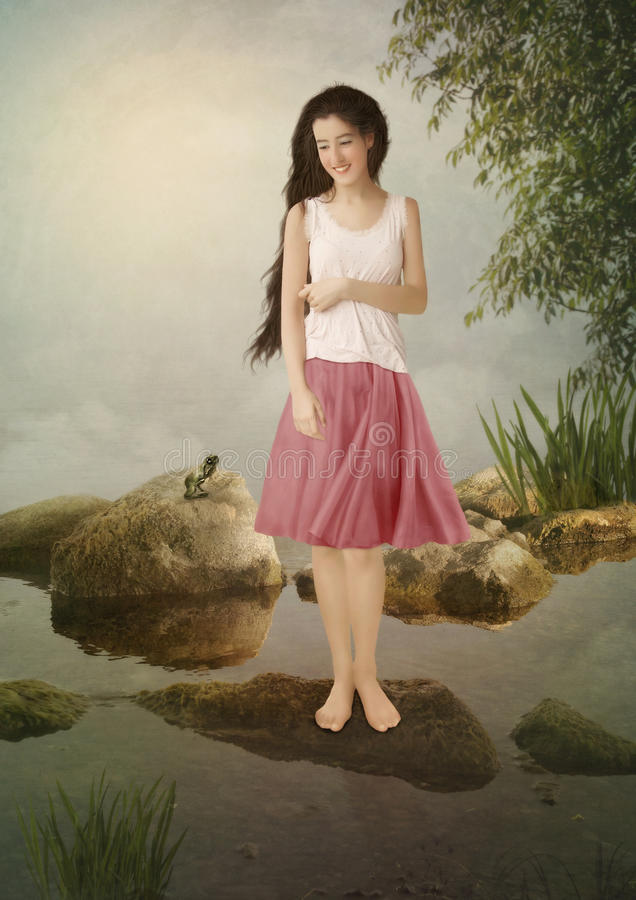 The girl and the froglet royalty free stock images