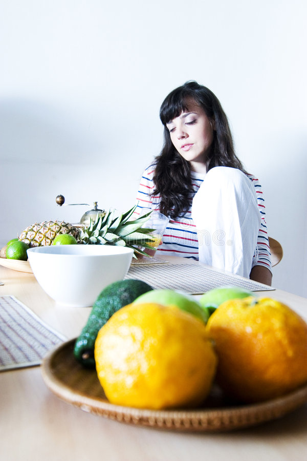 Girl In Front Of Bowl Of Fruit Stock Image