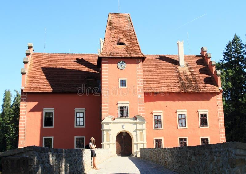 Girl in front of castle Cervena Lhota stock photos