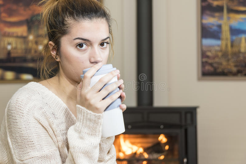 The girl in front of the fireplace in winter socks royalty free stock photography