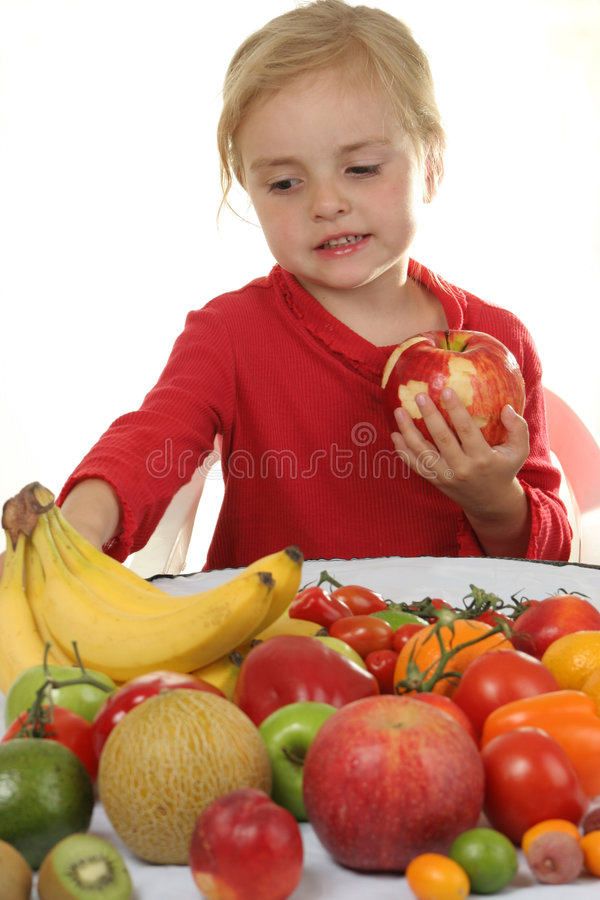 Girl and fruits royalty free stock photography