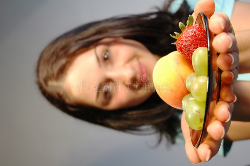 Girl with fruits3 royalty free stock photo
