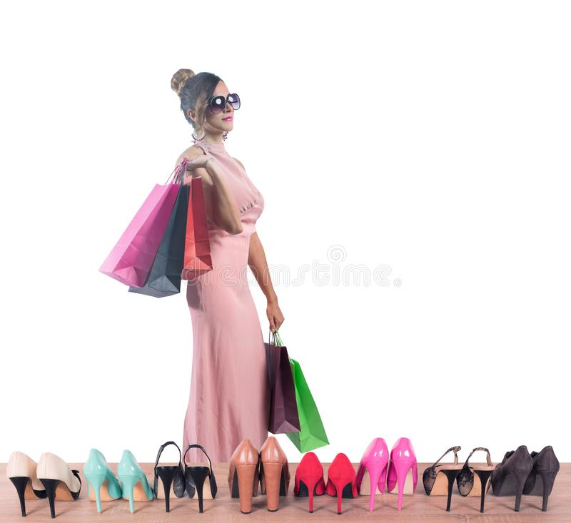 Girl full of bags does shopping in a store stock photos