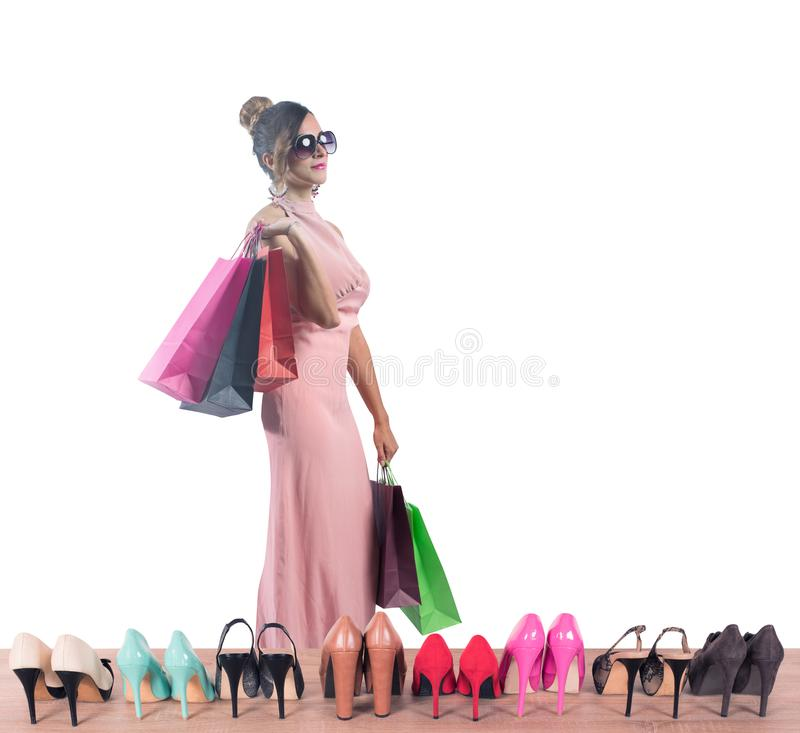 Girl full of bags does shopping in a store stock photography