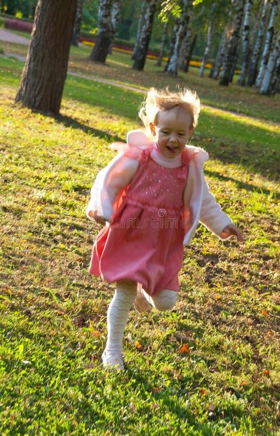 Free Girl Fun Runs In The Park Stock Photography - 13293352