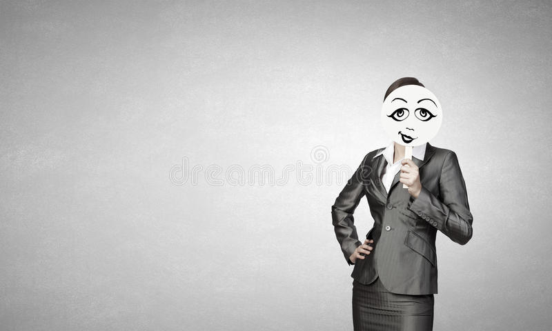 Girl with funny mask . Mixed media stock photo