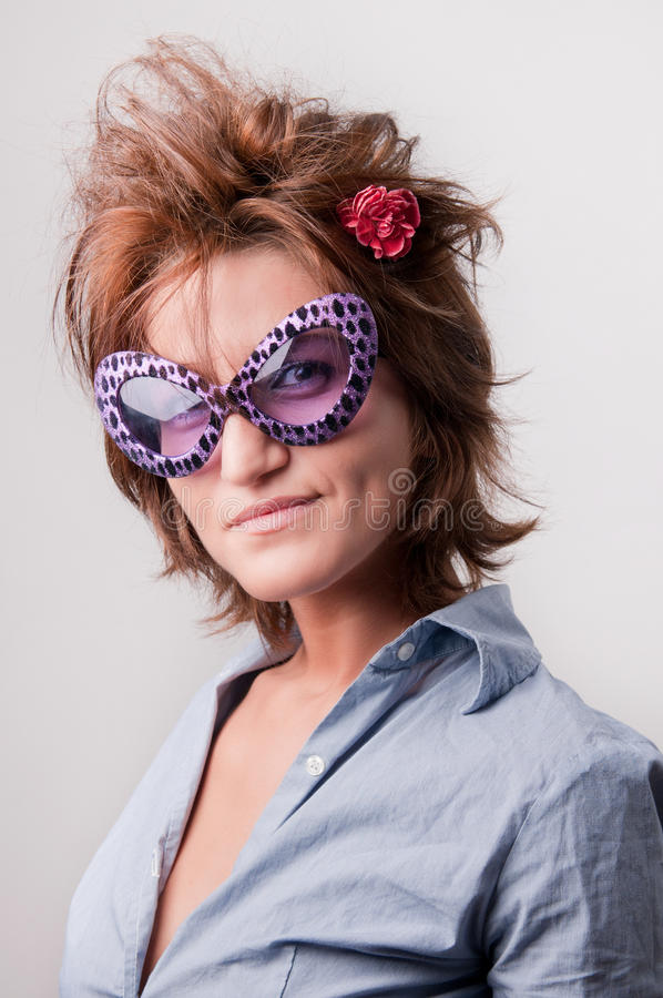 Girl with funny sunglasses royalty free stock image