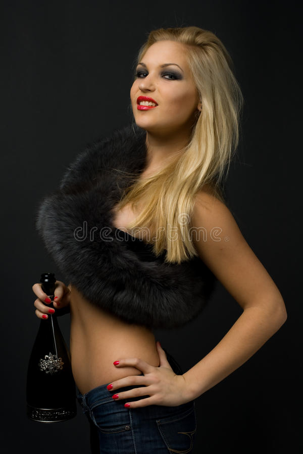 Girl with fur and champagne royalty free stock photography