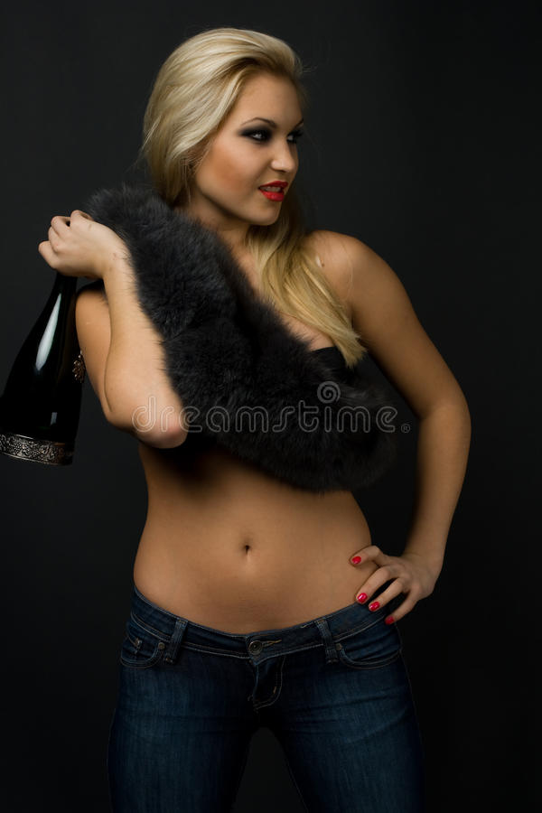 Girl with fur and champagne stock photos