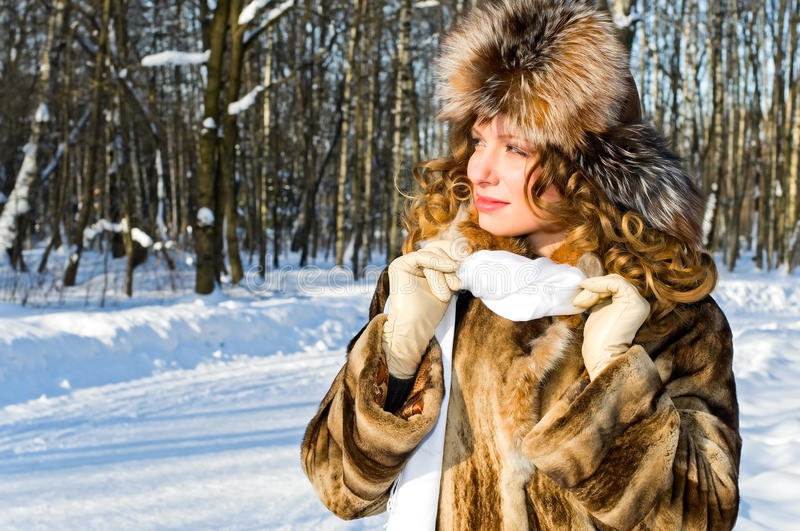 Girl in fur coat stock photos