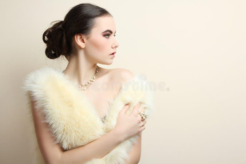 Girl in the fur coat stock image