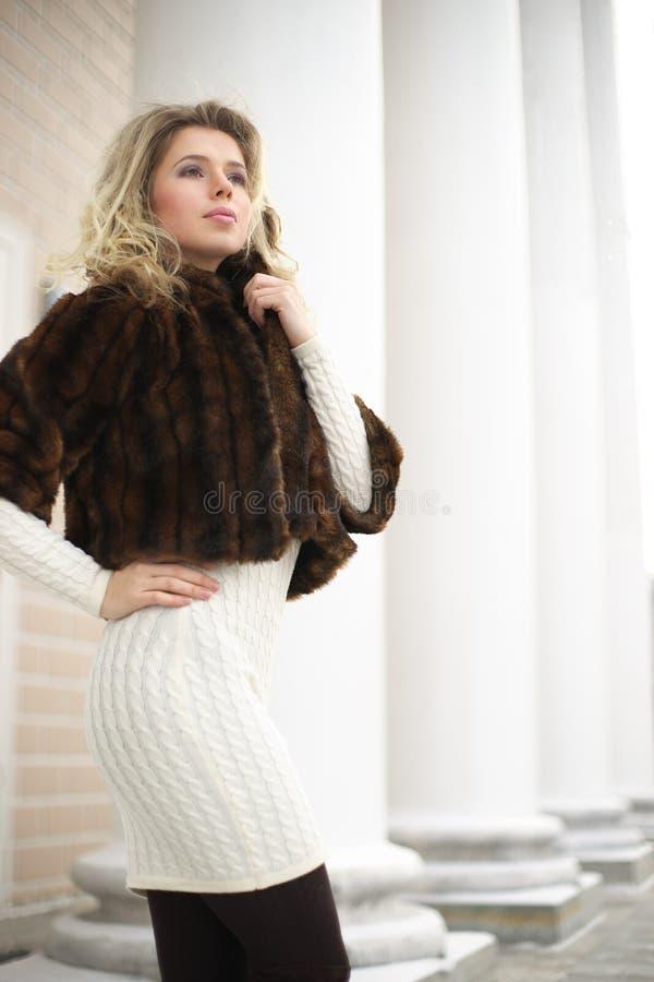 Girl in fur coat stock image