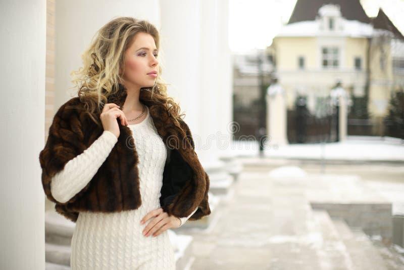 Girl in fur coat in profile royalty free stock images