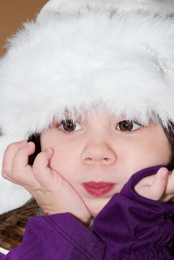 Download Girl in a fur hat stock photo. Image of hand, eyes, attractive - 14308962